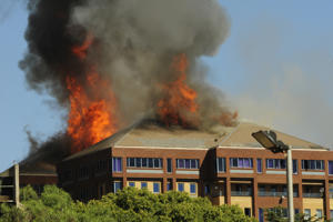 The Braamfontein Office Park roof and top floor on fire on April 18, 2017 in Johannesburg, South Africa. No one was injured and police have opened a case of arson and will be investigating what led to the Braampark ravaging fire.