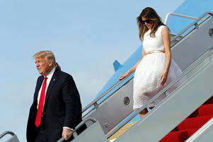 U.S. President Donald Trump and first lady Melania Trump board Air Force One in West Palm Beach, Florida, on April 16.