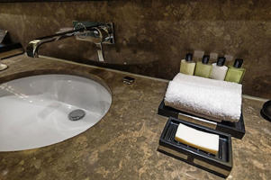 Do you reuse your towels and use bathroom amenities sparingly? (Photo courtesy: AFP Relaxnews/ assalve / Istock.com)