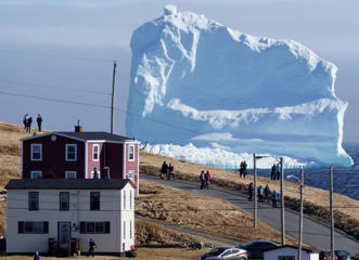 "Residents view the first iceberg of the season as it passes the South Shore, also known as ""Iceberg Alley"", near Ferryland Newfoundland, Canada April 16, 2017. Picture taken April 16, 2017."