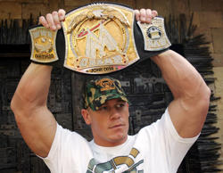MUMBAI, INDIA- FEBRUARY 9, 2006: WWF champion John Cena showing the belt during the visit of ten sprots events at Mahalaxmi Race course in Mumbai on Thursday.(Photo by Rajanish Kakade/Hindustan Times via Getty Images)