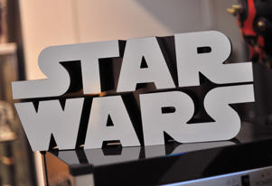 A Star Wars logo sign is seen atop a popcorn machine inside Rancho Obi-Wan, the world's largest private collection of Star Wars memorabilia, in Petaluma, California on November 24, 2015. The collection, owned by Steve Sansweet, includes over 350,000 Star Wars items and is located at his home. From the United States, to Russia, China and Saudi Arabia, the franchise has spawned a remarkable global fan base arguably unheard of in movie history and spanning several generations. AFP PHOTO/ JOSH EDELSON / AFP / Josh Edelson (Photo credit should read JOSH EDELSON/AFP/Getty Images)