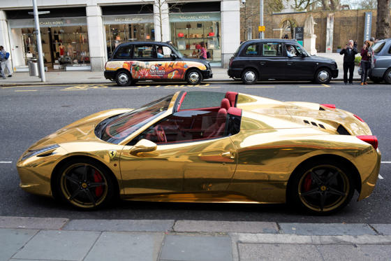 FERRARIA gold Ferrari sports car at Chelsea in London, U.K.