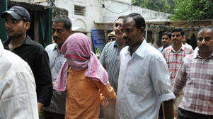 The minor accused (face covered) in being produced in court. (Sushil Kumar/HT File Photo)