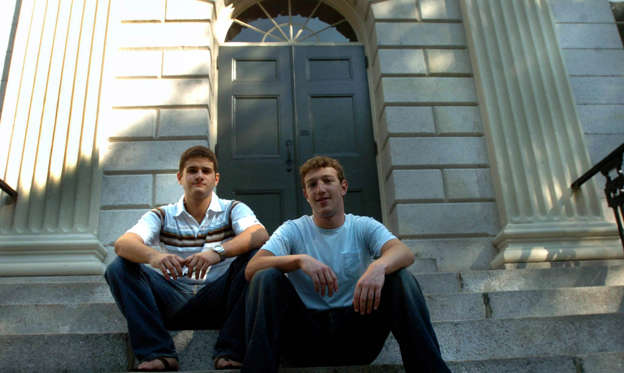 Slide 2 of 27: CAMBRIDGE - NOVEMBER 12: Founder of Facebook.com Mark Zuckerberg, right, and Dustin Moscovitz, co-founder, left; have their photo taken at Harvard Yard. The two are students at Harvard University who are taking the semester off. (Photo by Justine Hunt/The Boston Globe via Getty Images)