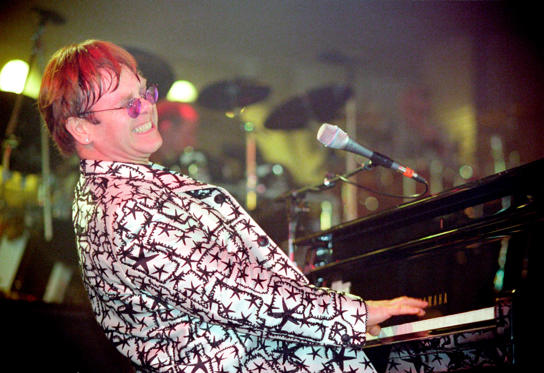 Slide 1 of 20: UNSPECIFIED - JANUARY 01: Photo of Elton JOHN (Photo by Phil Dent/Redferns)