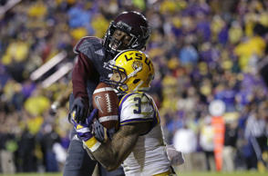 Texas A&M defensive back De'Vante Harris (1) breaks up a pass in the end zone intended for LSU wide receiver Odell Beckham (3) in the second half of an NCAA college football game in Baton Rouge, La., Saturday, Nov. 23, 2013. LSU won 34-10.
