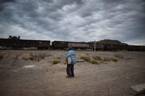 A Honduran migrant watches the train go by in the community of Caborca in Sonora state, Mexico, on January 13, 2017.