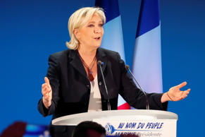 Supporters of Marine Le Pen cheered in celebration on Sunday in Hénin-Beaumont, ...