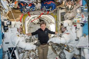 In this Jan. 13, 2017 file photo made available by NASA, astronaut Peggy Whitson, center, floats inside the Quest airlock of the International Space Station with Thomas Pesquet, left, and Shane Kimbrough before their spacewalk.