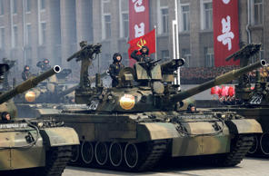 Soldiers in tanks are paraded across Kim Il Sung Square during a military parade...