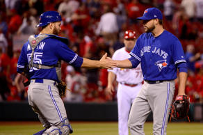Apr 25, 2017; St. Louis, MO, USA; Toronto Blue Jays relief pitcher Ryan Tepera (52) celebrates with catcher Russell Martin (55) after the Blue Jays defeated the St. Louis Cardinals in eleven innings at Busch Stadium.