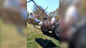 Granddad creates amazing swing on tractor