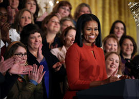 In this Jan. 6, 2017, file photo, First lady Michelle Obama smiles as she speaks at the 2017 School Counselor of the Year ceremony in the East Room of the White House in Washington.