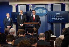 Treasury Secretary Steven Mnuchin, right, and Director of the National Economic ...