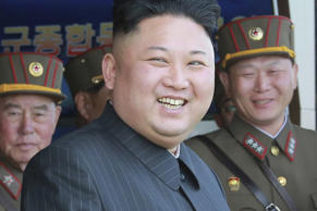 North Korea's leader Kim Jong Un watches a military drill.