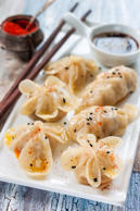 Chinese steam dumplings  gioza in various forming. Lotus flower