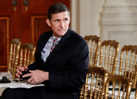 "In this Feb. 10, 2017 file photo, then-National Security Adviser Michael Flynn sits in the East Room of the White House in Washington. Documents released by lawmakers show Flynn, now former national security adviser, was warned when he retired from the military in 2014 not to take foreign money without ""advance approval"" by Pentagon authorities."