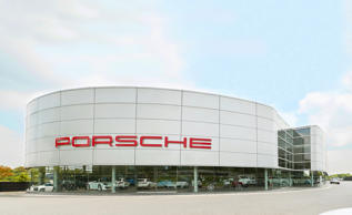 Although South Africa is far from Porsche's largest market (that's China), it does hold the distinction of housing the Porsche dealership with the largest footprint anywhere in the world. Finished in 2008, the sprawling Porsche Centre in Johannesburg employs 250 and, in addition to the typical sales and service areas, has body repair and painting capabilities, training facilities, and a gym. It also handles parts distribution for the whole country. Join us on a tour through its nearly 300,000 square feet.
