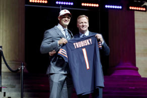 Mitchell Trubisky, left, of North Carolina poses with Commissioner of the National Football League Roger Goodell after being picked #2 overall by the Chicago Bears (from 49ers) during the first round of the 2017 NFL Draft at the Philadelphia Museum of Art on April 27, in Philadelphia, Penn.