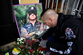 Conrad Cornelissen, a friend and Crusader, lights a candle in front of Durandt's Ink tattoo parlour in Norwood, where a small shrine set up for his deceased friend on April 24, 2017 in Johannesburg, South Africa. Durandt's girlfriend, Natasha de Abreu described Nick as a strong man who had so much love for his friends and family. Durandt, 53, a top South African boxing trainer died in a motorbike accident near Clarens in the Free State on 21 April, 2017.