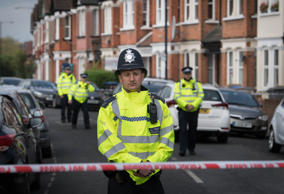 Police at the scene in Harlesden Road, London, after a woman in her twenties was...