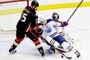 Edmonton Oilers goalie Cam Talbot, right, and defenseman Matthew Benning block a shot by Anaheim Ducks center Ryan Getzlaf, left, during the second period in Game 2 of a second-round NHL hockey Stanley Cup playoff series in Anaheim, Calif., April 28. The Oilers won 5-3.