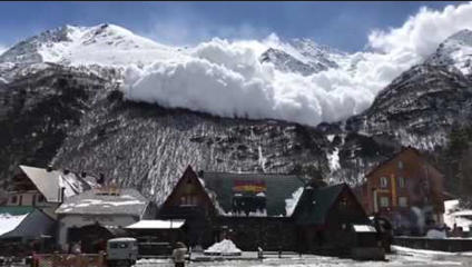 Avalanche comes close to ski resort in Terskol, Russia