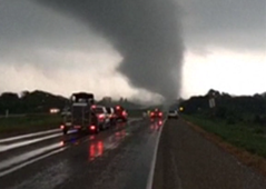 Motorists stop to watch Texas tornado cross highway