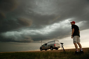 Hunter Anderson, a meteorology student at St. Cloud State University and current intern with the Center For Severe Weather Research, monitors a supercell thunderstorm as it develops, May 8, 2017 in Elbert County outside of Limon, Colorado.