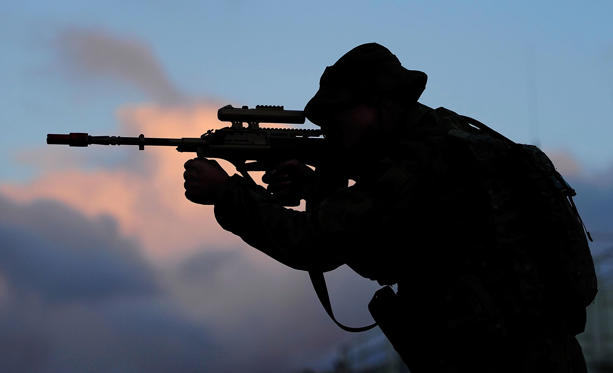 Slide 1 of 51: ROCKHAMPTON, AUSTRALIA - JULY 09: Captain Nick Garrett from Headquarters 7 Brigade looks through the sights of his rifle as part of exercise Talisman Sabre on July 9, 2015 in Rockhampton, Australia. Talisman Sabre is a biennial military exercise that trains Australian and U.S. forces to plan and conduct combined task force operations to improve combat readiness and interoperability on a variety of missions from conventional conflict to peacekeeping and humanitarian assistance efforts. TS15 will incorporate force preparation activities, Special Forces activities, amphibious landings, parachuting, land force manoeuvre, urban operations, air operations, maritime operations and the coordinated firing of live ammunition and explosive ordnance from small arms, artillery, naval vessels and aircraft. (Photo by Ian Hitchcock/Getty Images)