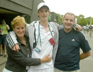 Great Britain's Andrew Murray, the second seed in the boy's singles with his parents Judy and Will at The Lawn Tennis Championships at Wimbledon, London, where Murray defeated Alexandra Nedovesov from Urkaine in straight sets 6:2/6:2.