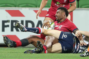Samu Kerevi of the Reds scores the match-winning try during the round 12 Super Rugby match between the Melbourne Rebels and the Queensland Reds.