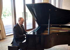 Russian President Vladimir Putin plays piano before meeting Chinese leader Xi Jinping on the first day of the Belt and Road Forum in Beijing, China May 14, 2017.