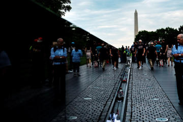 People visit the Vietnam Memorial on the National Mall on May 27, 2017 in Washington, DC.