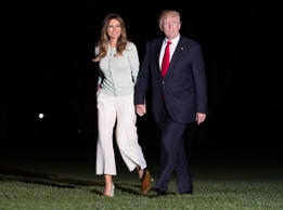 President Donald Trump and first lady Melania Trump walk from Marine One across the South Lawn to the White House in Washington, Saturday, May 27, 2017, as they return from Sigonella, Italy
