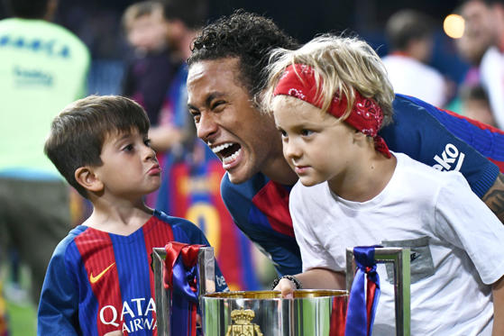Slide 1 of 79: Neymar da Silva Santos of FC Barcelona with his son and Lionel Messi son after the Copa del Rey final match between FC Barcelona and Deportivo Alaves played at the Vicente Calderon Stadium, Madrid, Spain on 27th May 2017.