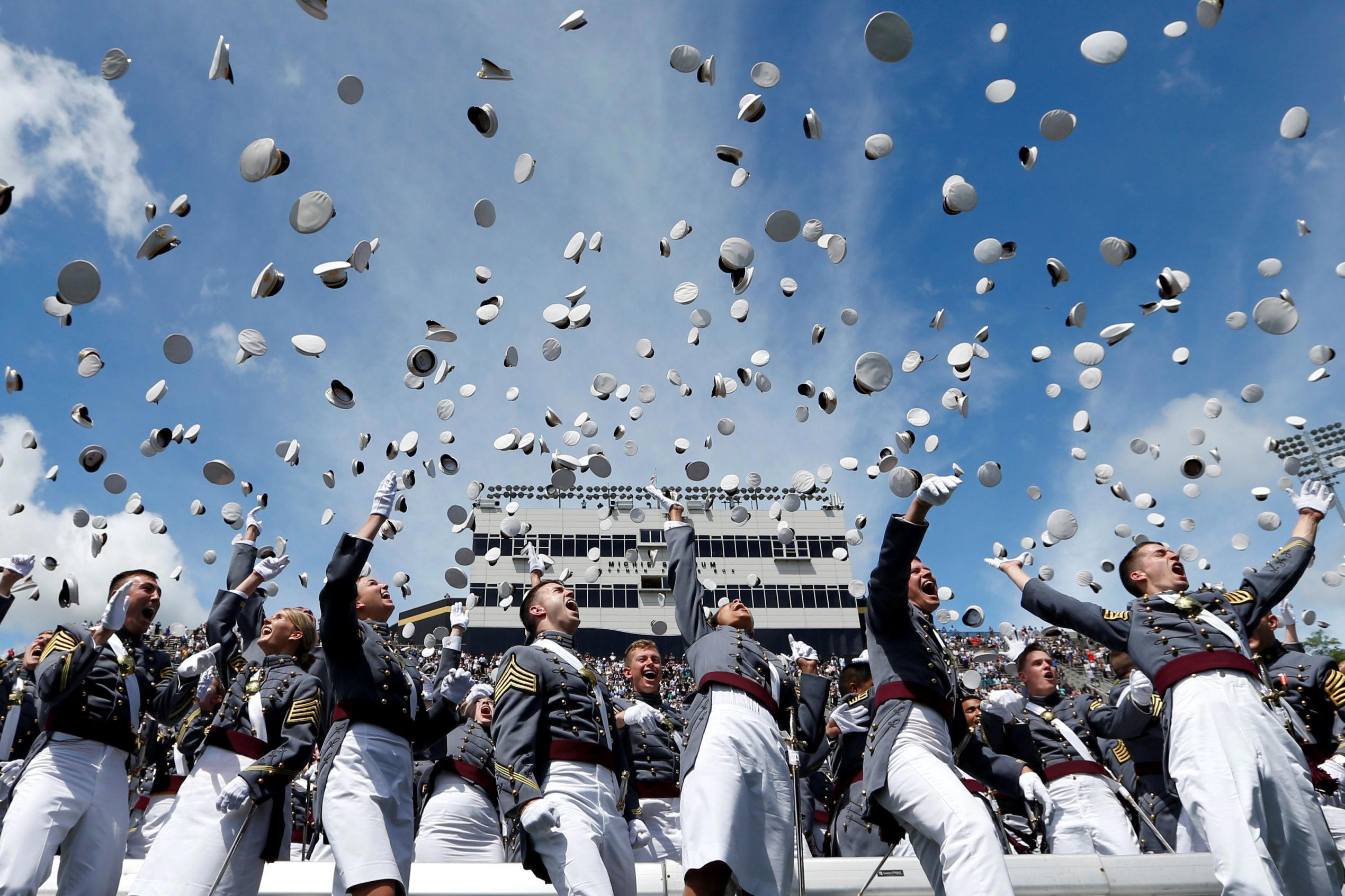 Slide 1 of 100: Graduates of the United States Military Academy toss their hats into the air at the conclusion of commencement ceremonies in West Point, New York, U.S., May 27, 2017.