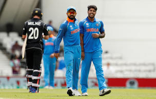 India's Umesh Yadav celebrates taking the wicket of New Zealand's Adam Milne