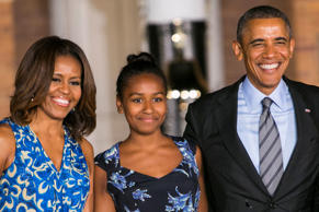 First Lady Michelle Obama, left, daughter Sasha Obama, center, and President Barack Obama, left, attend the Marine Barracks Evening Parade in Washington, D.C., on June 27, 2014.