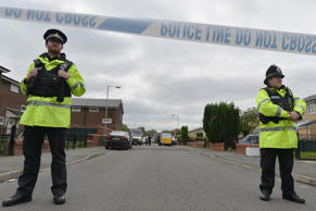 Police close the road leading to Quantock Street in the Moss Side area of Manchester where a raid was carried out earlier on May 28, 2017 in Manchester, England.