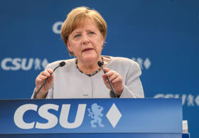 German Chancellor Angela Merkel delivers a speech during a joint campaigning event of the Christian Democratic Union (CDU) and the Christion Social Union (CSU) in Munich, southern Germany, on May 27, 2017.