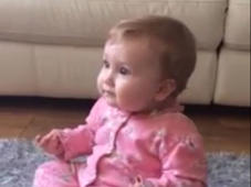 Cute baby uses sign language