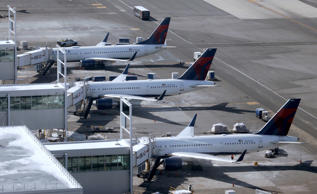 Planes on the tarmac at John F. Kennedy International Airport in New York, Thursday, March 16, 2017