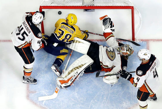 Slide 4 of 75: Anaheim Ducks goalie John Gibson (36) and Nashville Predators left wing Viktor Arvidsson (38), of Sweden, fall to the ice as a shot by Nashville Predators left wing Filip Forsberg, of Sweden, not shown, gets past for a goal during the third period in Game 3 of the Western Conference final in the NHL hockey Stanley Cup playoffs Tuesday, May 16, 2017, in Nashville, Tenn. The Predators won 2-1 and lead the series 2-1. Also defending for the Ducks are Sami Vatanen (45), of Finland, and Cam Fowler (4).