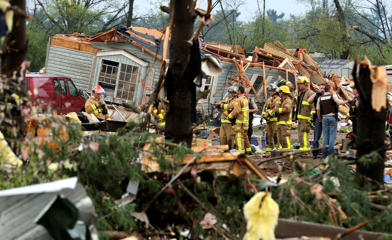Firefighters work the site of the damage after a tornado ripped through Prairie Lake Estates trailer home park, just north of Chetek, Wis., Tuesday, May 16, 2017. The tornado swept into the mobile home park in western Wisconsin on Tuesday, as a storm system also pounded parts of at least seven states from Texas to near the Canadian border with heavy rain, high winds and hail.