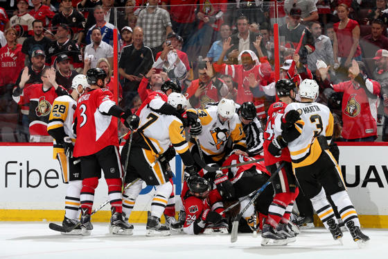 Slide 3 of 75: The Ottawa Senators fight the Pittsburgh Penguins during the third period in Game Three of the Eastern Conference Final during the 2017 NHL Stanley Cup Playoffs at Canadian Tire Centre on May 17, 2017 in Ottawa, Canada.