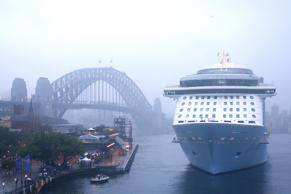 SYDNEY, AUSTRALIA - DECEMBER 15: MS Ovation of the Seas docks for the first time at Overseas Passenger Terminal on December 15, 2016 in Sydney, Australia. Royal Caribbean's Ovation of the Seas has made its debut voyage to Australia this week, arriving in Perth then travelling to Adelaide, Hobart and Sydney. At the length of 348 m (1,142 ft) and gross tonnage of 168,666, it's the world's fourth-biggest cruise ship, and the largest to visit Australia. (Photo by Matt Blyth/Getty Images)