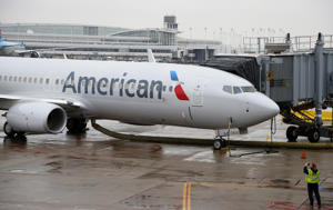 A New American Airlines 737-800 Aircraft with a New Painting and the Company's New Logo Sits at a Gate at the O'hare International Airport in Chicago Illinois Usa 29 January 2013 United States Chicago