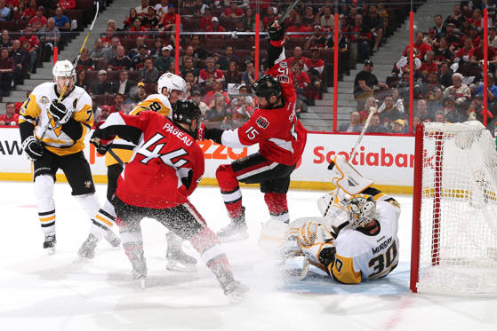 Slide 1 of 75: Zack Smith #15 of the Ottawa Senators trips over Matt Murray #30 of the Pittsburgh Penguins during the second period in Game Three of the Eastern Conference Final during the 2017 NHL Stanley Cup Playoffs at Canadian Tire Centre on May 17, 2017 in Ottawa, Canada.